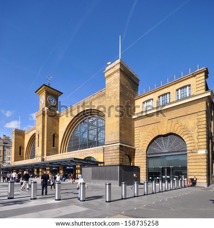 LONDON - OCTOBER 6. Renovated facade of King's Cross railway terminus for the east coast main line service from Edinburgh and Leeds, with new pedestrian concourse, on October 6, 2013, in London UK, - stock photo