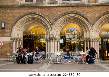 LONDON - OCTOBER 18TH: The exterior of Mcdonalds  on October 18th, 2014 in London, england, uk. Mcdonalds is the biggest fast food chain in the world. - stock photo