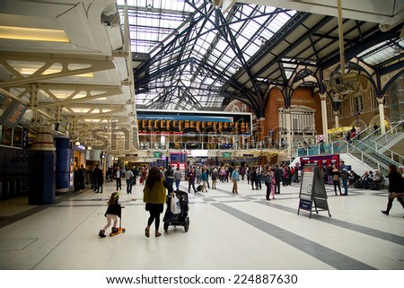 LONDON - OCTOBER 18TH: The interior of Liverpool street station on October 18th, 2014 in London, england, uk. The london underground is the oldest underground system in the world. - stock photo