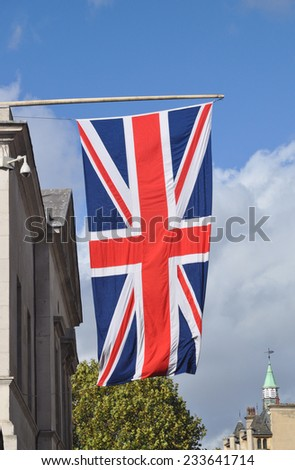 LONDON - OCTOBER 19. The Union flag flying at the entrance to Horse Guards Parade, the location for the Changing of the Guard and other ceremonies at Whitehall on October 19, 2014 in London, UK. - stock photo