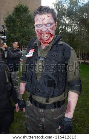 LONDON - OCTOBER 13: Unidentified man dresses as zombie celebrates World Zombie Day London 2012 on October 13, 2012 in London, England.