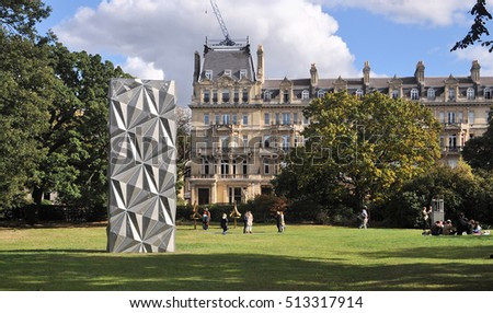 LONDON - OCTOBER 9, 2016. Visitors enjoy the English Gardens area in Regent's Park with the Optic Cloak, a construction designed by Conrad Shawcross, located in London, UK.