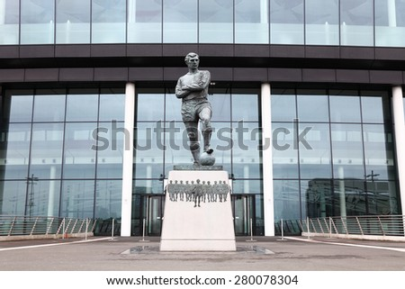LONDON - on 25th May : Wembley Stadium, London on 25Th May,2014. Photo of the Bobby Moore statue outside Wembley Stadium,