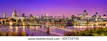 London Panorama:  St. Paul's Cathedral, Millennium Bridge and  the Financial District at twilight. - stock photo
