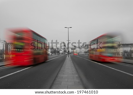 London Red Buses on a road in London blurred by motion - stock photo