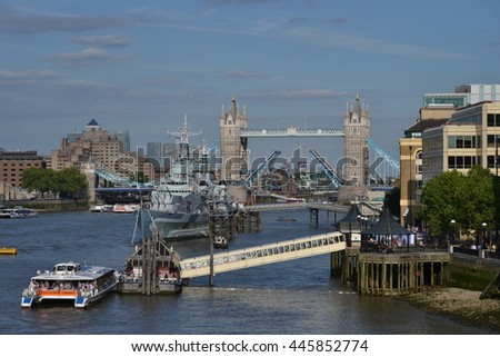 London river Thames skyline with open Tower Bridge HMS Belfast museum ship and sightseeing boat. Circa 2015 river Thames London with open Tower Bridge HMS Belfast and sightseeing boat