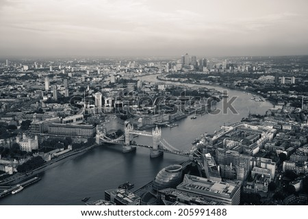 London rooftop view panorama at sunset with urban architectures and Thames River. - stock photo
