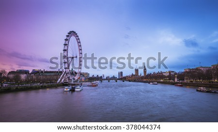London's skyline view at dusk with famous landmarks, Big Ben, Houses of Parliament and ships on River Thames with beautiful blue and purple sky - London, UK - stock photo