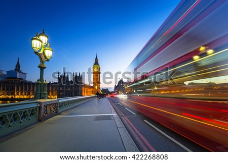 London scenery at Westminter bridge with Big Ben and blurred red bus, UK - stock photo