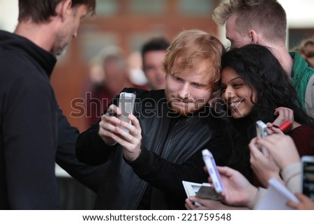 LONDON - SEP 30: Ed Sheeran seen leaving BBC studios on 30, Sep, 2014 in London - stock photo