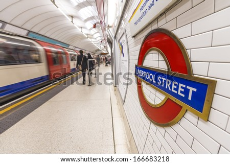 LONDON - SEP 27: Inside view of London underground  Station on September 27, 2013 in London, UK. London's system is the oldest underground railway in the world, dating back to 1863.  - stock photo