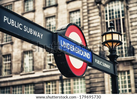 LONDON - SEP 29, 2013: London Underground station entrance sign. London Underground is the 11th busiest metro system worldwide with 1.1 billion annual rides. - stock photo