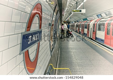LONDON - SEP 30: London Underground station symbol on September 30, 2012 in London. London Underground is the 11th busiest metro system worldwide with 1.1 billion annual rides - stock photo