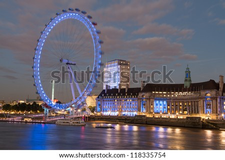 LONDON - SEP 28 : View of The London Eye at night on September 28, 2012 in London, England. This is one of the most famous tourist attraction over river Thames in the capital - stock photo