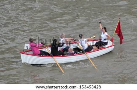 LONDON- SEPT 7: Crews rowing between tower and london bridges, visit london during river thames week, LONDON, SEPT 7, 2013 - stock photo