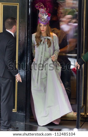 LONDON - SEPT 10: Lady Gaga leaves the Dorchester Hotel, Sept 10, 2012 in London, UK - stock photo