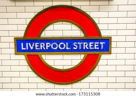 LONDON - SEPT 27: Liverpool Street Gate Underground station sign on September 27, 2013. The London Underground is the oldest metropolitan railway in the world, dating from 1863.  - stock photo