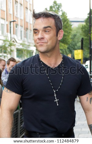 LONDON - SEPT 10: Robbie Williams visits BBC Radio One, Sept 10, 2012 in London, UK