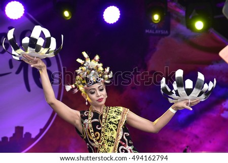 LONDON - SEPTEMBER 24: A Malaysian cultural dancer performing the Enggang Dance at the Malaysia Fest 2016 in Trafalgar Square, London, UK, SEPTEMBER 24, 2016. The Festival is now in its 7th Year.