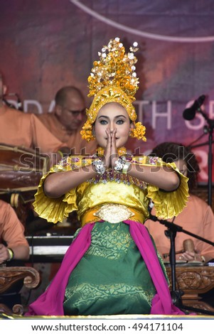 LONDON - SEPTEMBER 24: A Malaysian Cultural Dancer performing the Timang Burung Dance at the Malaysia Fest 2016 in Trafalgar Square, London, UK, SEPTEMBER 24, 2016. The festival is now in its 7th year