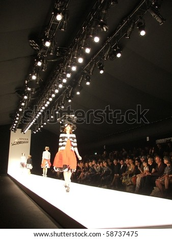 LONDON - SEPTEMBER 19: A model walks the runway for the Kinder Aggugini Spring/ Summer Collection 2010 at London Fashion Week on September 19, 2009 in London - stock photo