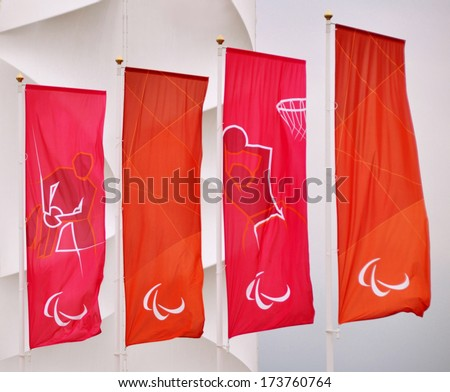 LONDON - SEPTEMBER 4. Banners with sports graphics and the Paralympics Agitos symbol flying on September 4, 2012 by the Basketball Arena at the Olympic Games, Stratford, east London, UK. - stock photo
