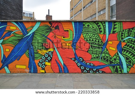LONDON - SEPTEMBER 27. Painted mural on building site hoarding on September 27, 2014 in Hanbury Street in the east end of London, UK. - stock photo