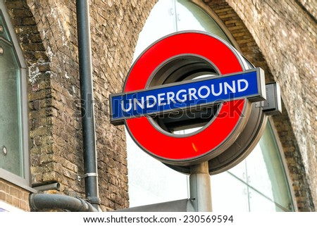 LONDON - SEPTEMBER 28, 2013: Subway sign on the street. London subway system serves 270 stations and has 402 kilometres (250 mi) of track. - stock photo