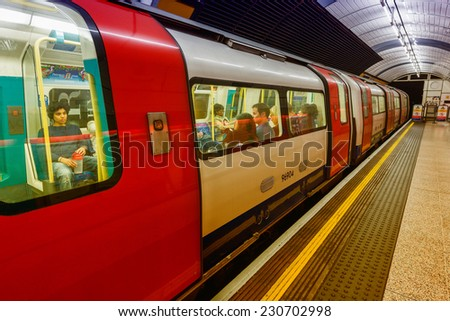 LONDON - SEPTEMBER 28, 2013: Subway train in underground station. London subway system serves 270 stations and has 402 kilometres (250 mi) of track. - stock photo