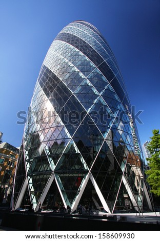LONDON - SEPTEMBER 24: The Gherkin building in London, England on September 24, 2009. The building was awarded a Royal Institute of British Architects Stirling Prize in 2004. - stock photo
