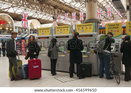 LONDON - September 1, 2015: Ticket Issuing Machines at Victoria rail station in London, UK. Victoria is the second busiest train station in the UK with 73 million passengers entry and exits. - stock photo