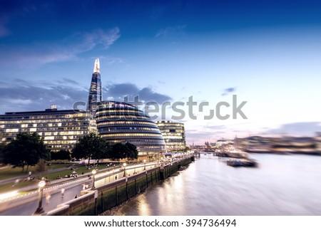 London skyline at sunset along Thames. - stock photo