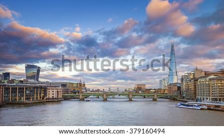 London skyline at sunset from Millennium Bridge with Tower Bridge, Shard and other famous landmarks - London, UK - stock photo