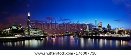 London skyline panorama at night, England the UK. Tower of London, The Shard, City Hall, River Thames as seen from Tower Bridge - stock photo