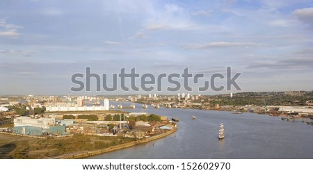 London Skyline, seen from the Emirates Air Line cable car, inclouding Thames Barrier.  - stock photo