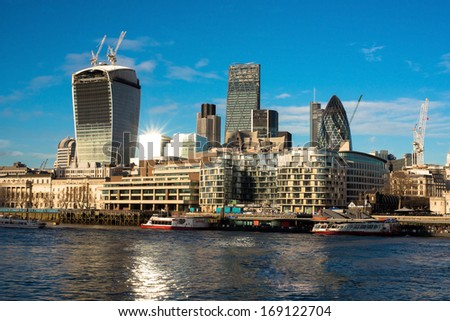 London skyline seen from the River Thames at twilight, London, December, 2013. - stock photo