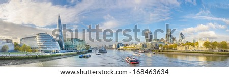 London skyline, United Kingdom - cityscape with modern buildings and Tower of London in autumn under blue bright sky - stock photo
