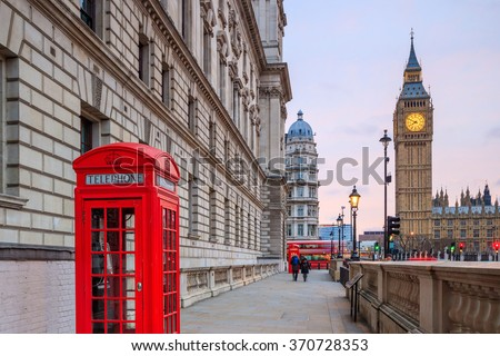 London skyline with Big Ben and Houses of parliament at twilight in UK.