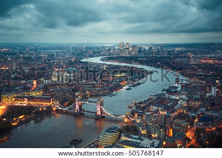 London skyline with illuminated Tower bridge and Canary Wharf at the dusk, The United Kingdom of Great Britain and Northern Ireland