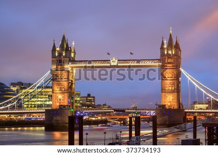 London skyline with Tower Bridge at twilight in UK.