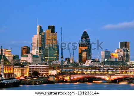 London Skylines Skyscrapers along River thames at dusk England UK - stock photo