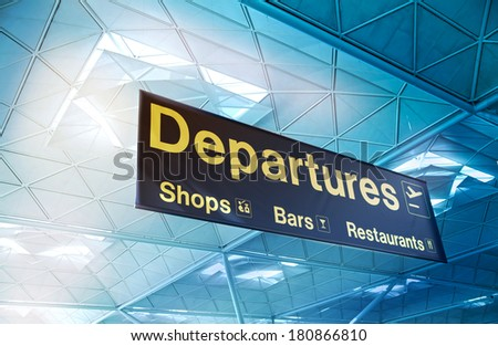 LONDON STANSTED AIRPORT, UK - MARCH 23, 2014: yellow departure sign at a international airport - stock photo