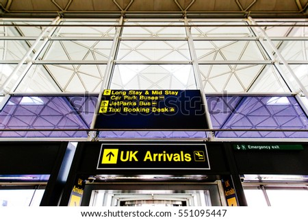 LONDON STANSTED AIRPORT, UK - MAY 5, 2016: Airport Stansted signage, UK arrivals, Taxi Booking Desk, Long Stay, Car Park Buses, Mid Stay