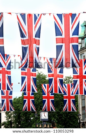 London street decorated with bunch of British flags - stock photo