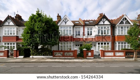 London street of early 20th century Edwardian terraced houses, without parked cars. - stock photo