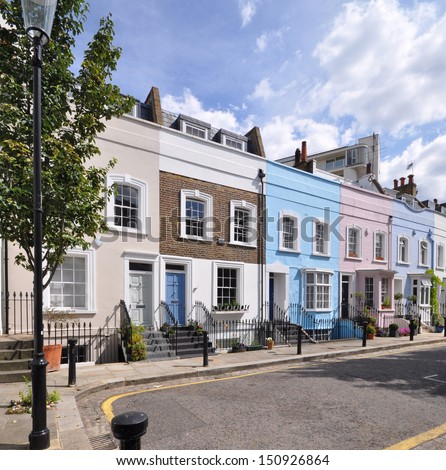 London street of old terraced houses, without parked cars. - stock photo