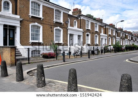 London street of typical small 19th century Victorian houses without parked cars. - stock photo
