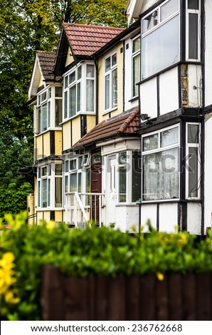 London suburb, with terraced houses and buildings - stock photo