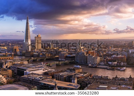 London sunset with amazing clouds and skyscraper - UK - stock photo