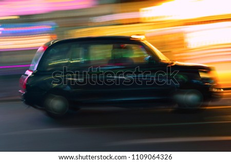 stock-photo-london-taxi-motion-blur-nigh